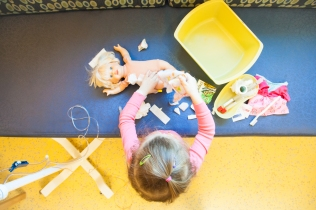 12/26-29 Hosp for 3rd Metho: Since Natalie's diagnosis one of her FAVORITE things to play is doctor. The nurses always give her some real supplies to play with so she LOVES this. Note the doll in the photo, it's the same one I made a port for…this doll came with us to every hospital stay and had everything done that Natalie had to have done. She really loved doing this and it helped us to explain procedures to her a bit.