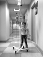 """Natalie was pushing her IV pole as she wanted to """"take a walk"""" around the clinic.  She looks so big in this photo.  It was a """"sleepy room"""" day which meant a spinal of methotrexate and an aspirate to make sure her fluid is still clear of leukemia."""