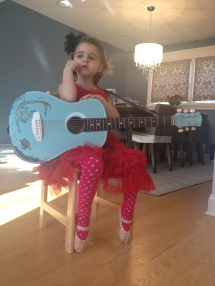 Natalie has recently had a bad month…this photo was taken on her first GREAT day. Seeing her wear her everyday red dress and break out her guitar meant EVERYTHING to me.