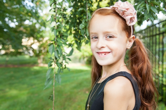 7-year-old Hannah Rose is bravely shaved off her beautiful red locks to honor her 5-year-old sister Natalie Grace (who is in remission from cancer, set to be complete with chemo this November), as well as to honor every other child fighting and who has fought childhood cancer.  Her goal was to show these children that they are not alone.